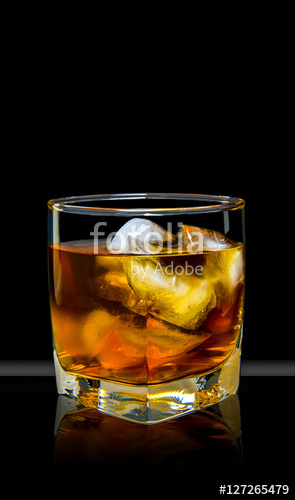 whiskey with ice in a glass
