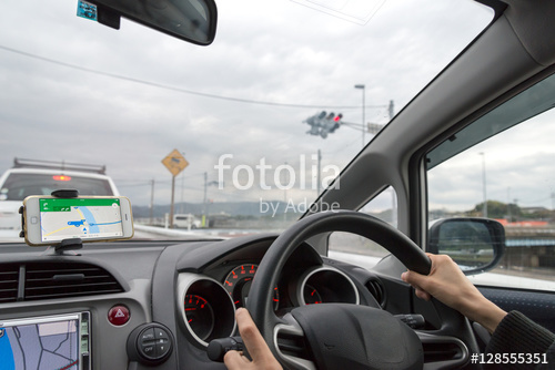 woman driving a car using navigation system